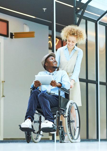lady helping man in wheelchair