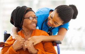 caretaker hugs elder woman