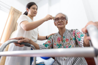 care giver taking care of the old woman in the wheel chair