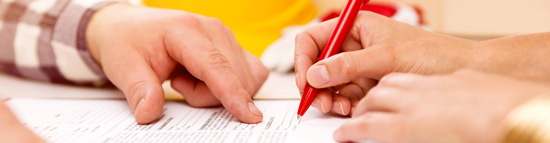 man fingers pointed at the pen signature of the girl